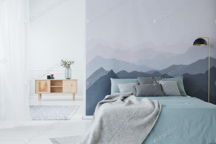 Blue and grey bedroom interior