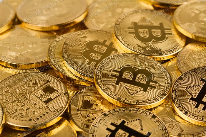pile of golden bitcoins background texture