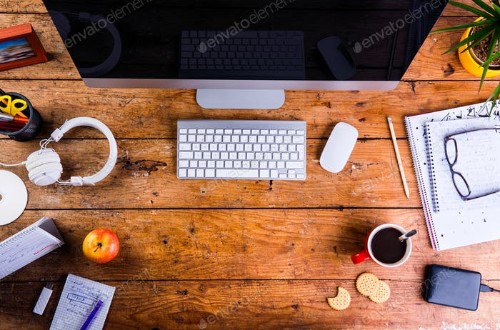 Desk with various gadgets and office supplies. Flat lay