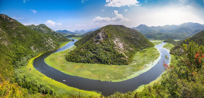 Fantastic view of the Crnojevic river bend around green mountain peaks on a sunny day