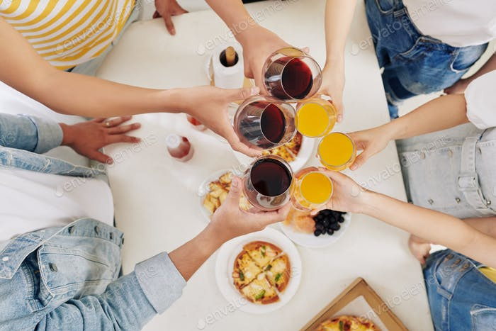 Friends toasting at party
