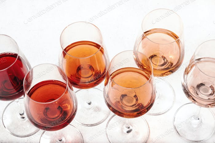 Rose wine glasses on wine tasting. Degustation different varieties, colors and shades of pink wine