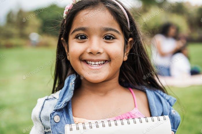Portrait of indian female kid at city park