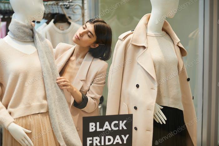 Saleswoman Arranging Window Display