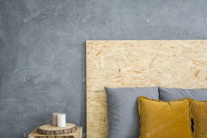 Wooden headboard and grey wall