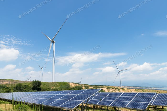 renewable energy landscape, solar panels and wind turbines with blue sky
