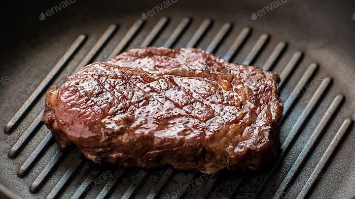 Meat on frying pan