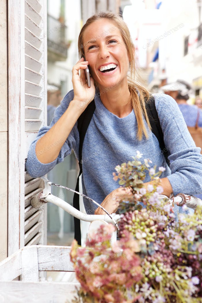 cheerful young woman talking on mobile phone