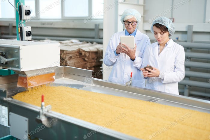 Women Overseeing Production at Factory