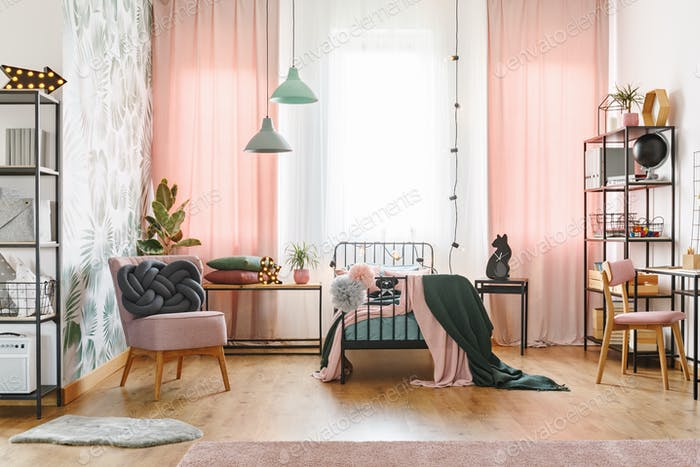 Pastel pink girl's bedroom interior