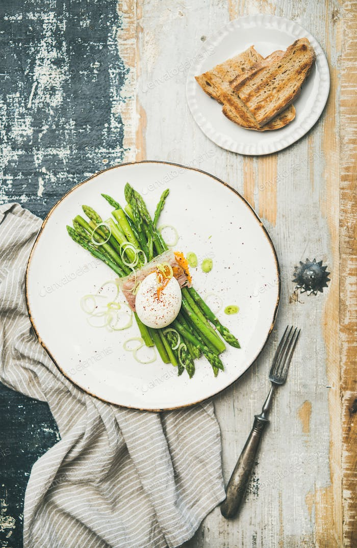Healthy breakfast with green asparagus, soft-boiled egg , bacon and bread
