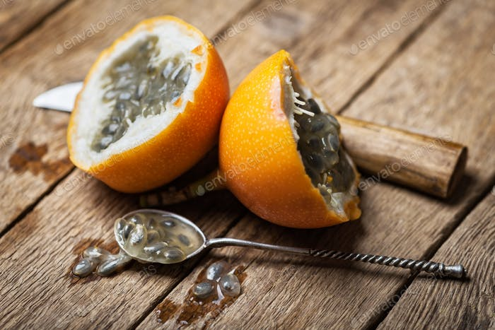 Slised passion fruit with knife and spoon