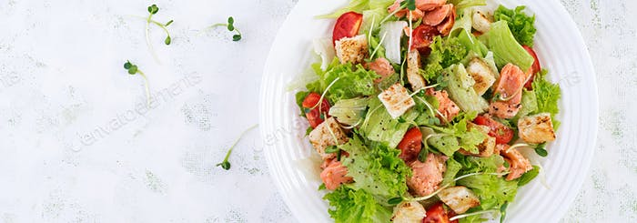 Caesar Salad with Salmon. Fish menu. Seafood - salmon. Top view, overhead, banner