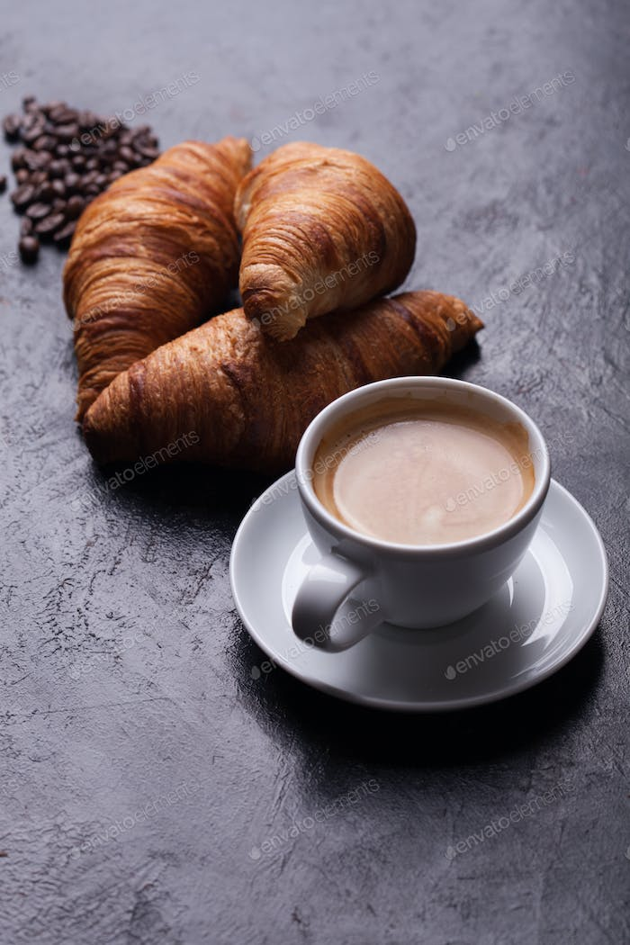 Breakfast with freshly baked croissants and cup of coffee