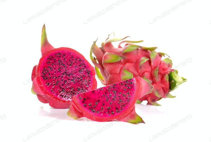 Fresh red dragon fruit on white background.