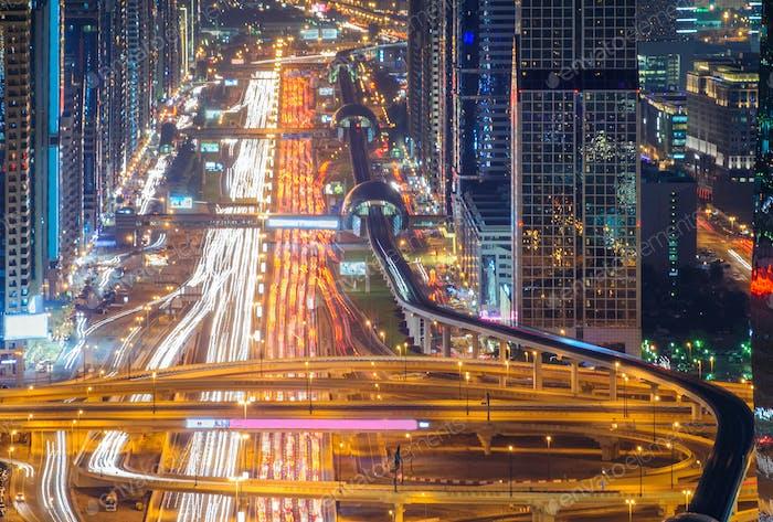 Amazing night dubai downtown skyline and road leading to Abu Dhabi, Dubai, United Arab Emirates