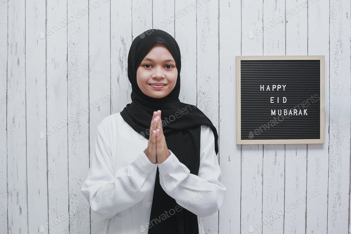 Young Muslim Woman With Greeting Pose on Eid Mubarak