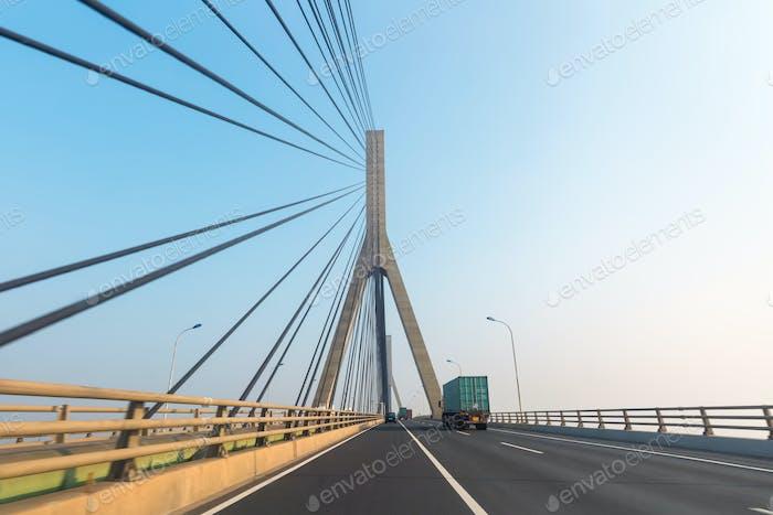container trucks on bridge