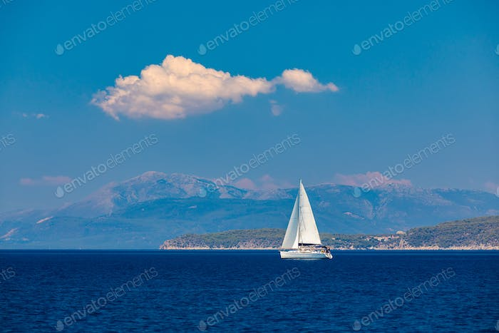 Lonely yacht sailing on silent sea. Turkey