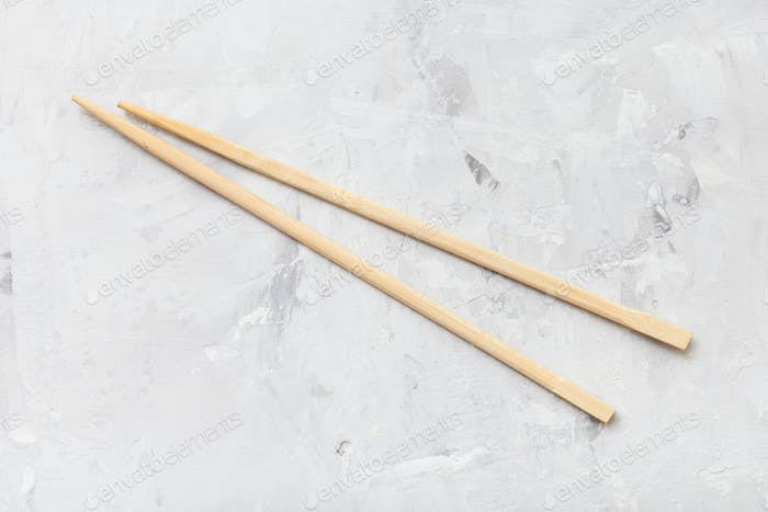 wooden disposable chopsticks on concrete board