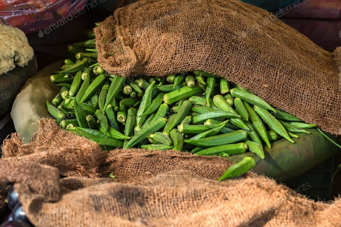 Pile of fresh okra for sale in market