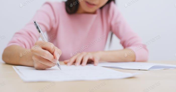 Student doing homework at home