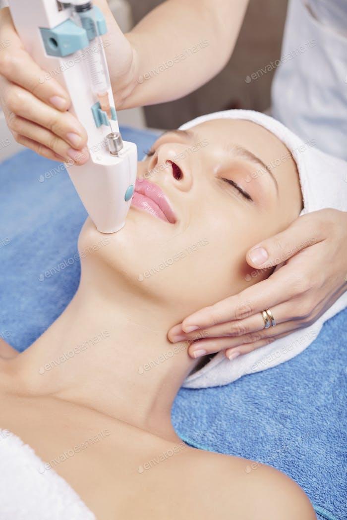 Woman enjoying beauty treatment