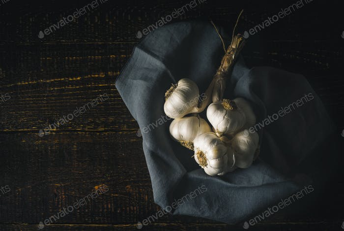 Bunch of garlic with napkin on the wooden table horizontal