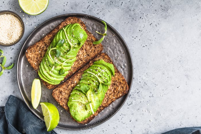 Top view on two toasts with avocado