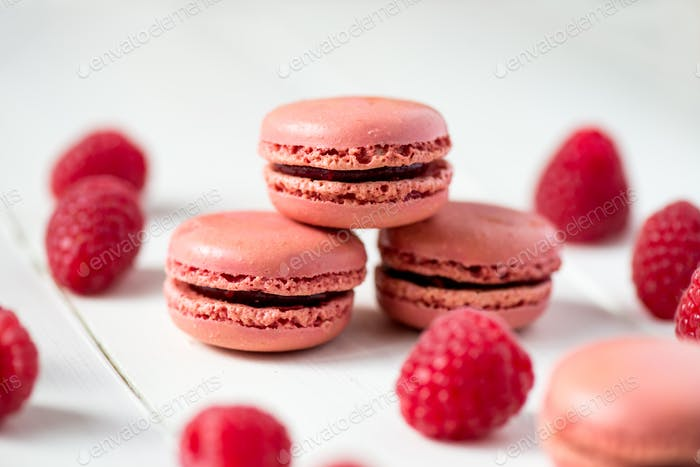 Raspberry Macaroons with Raspberries on Light Background