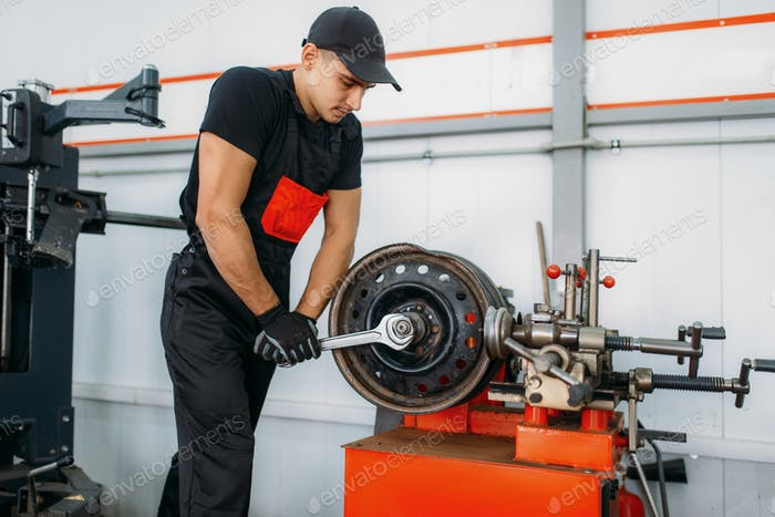 Mechanic repairs a crumpled disc, tire service