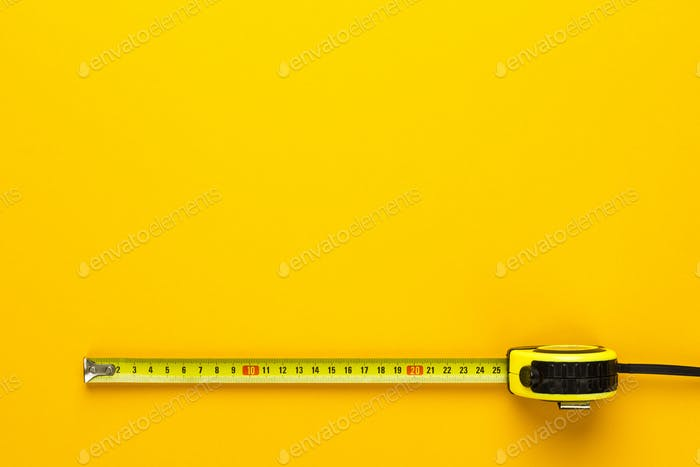 Tape Measure On The Yellow Background