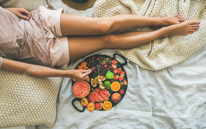 Summer healthy clean eating breakfast in bed concept, copy space