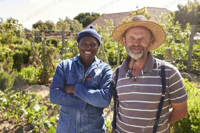 Portrait Of Two Men Working On Community Allotment