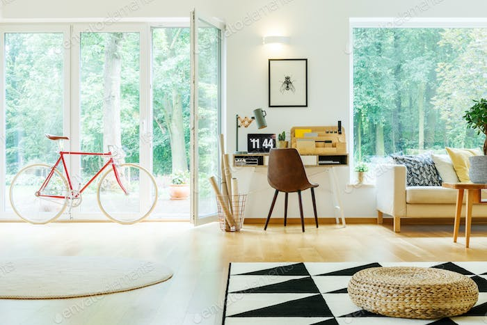 Spacious living room with pouf