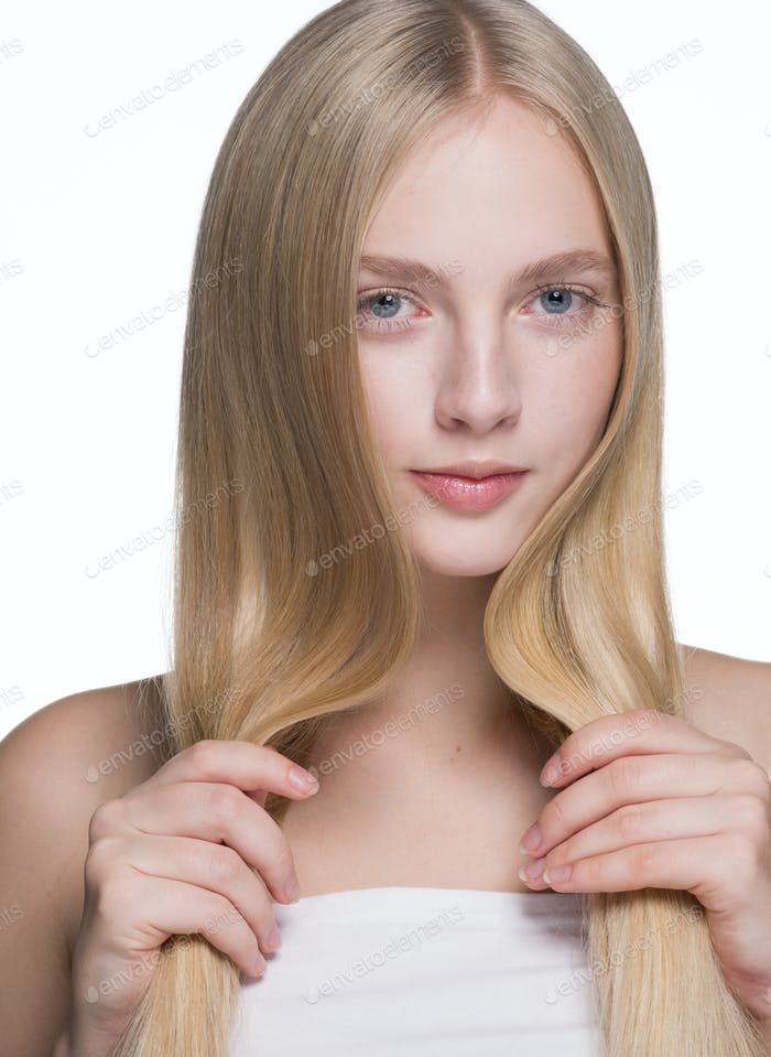 Smooth long hair woman blond natural healthy hairstyle female  beauty portrait