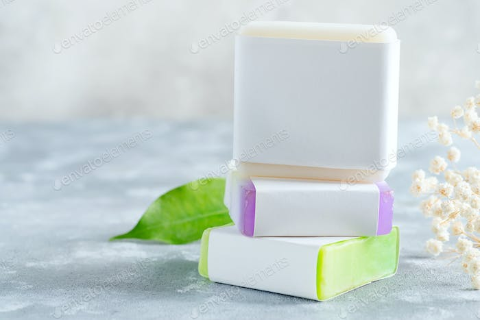 Colorful handmade herbal natural soap bar from organic plant and ingredients with mock-up paper