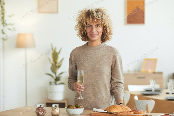 Smiling Woman Hosting Dinner Party