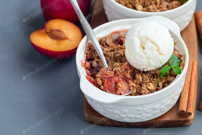 Plum crumble pie or plum crisp with oats and spices, served with