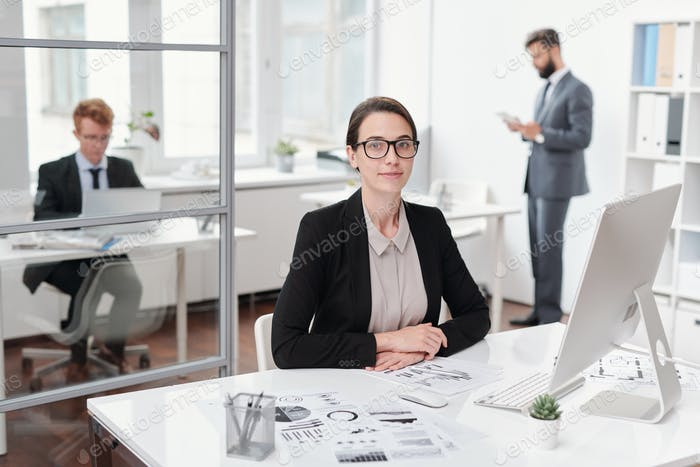 Business Intern Posing at Workplace
