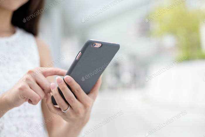 Woman browsing internet on mobile phone