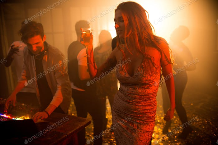 Elegant Young Woman Enjoying Music in Club