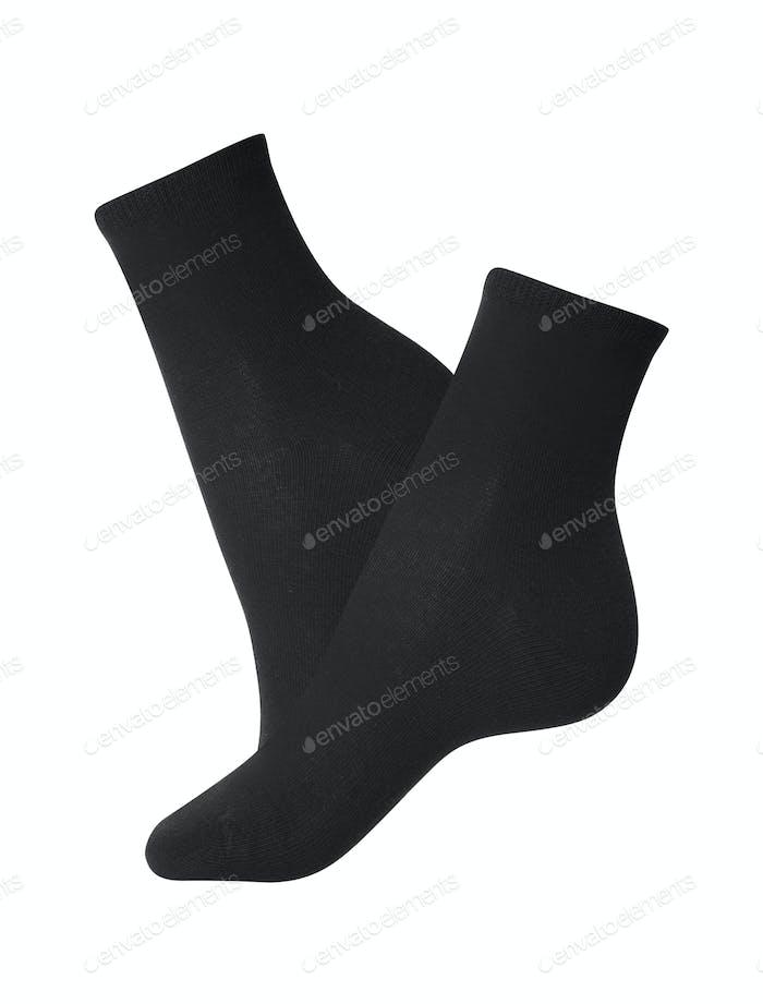 Black socks close-up on a white background