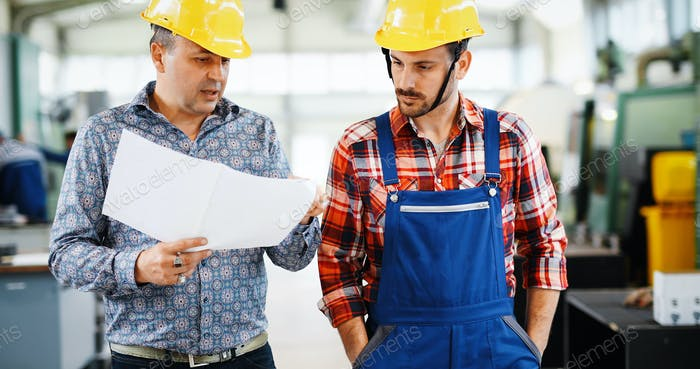Thumbnail for Factory worker discussing data with supervisor in metal factory