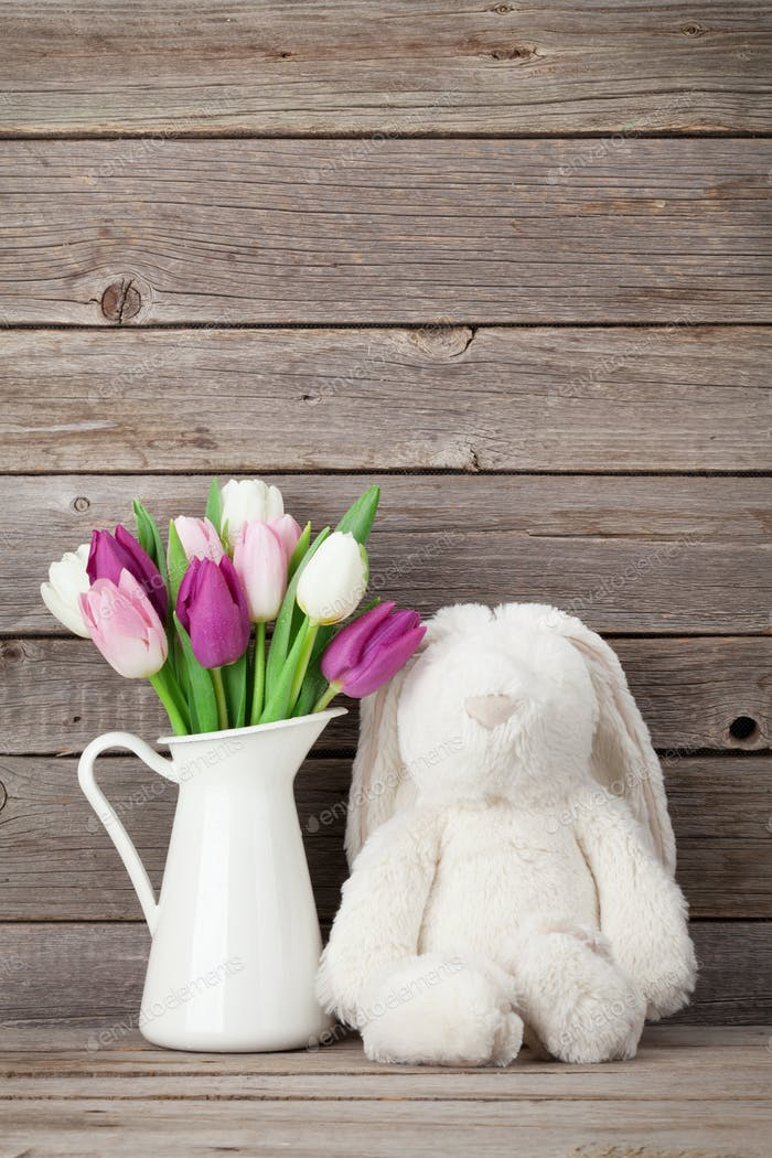 Colorful tulips bouquet and rabbit toy