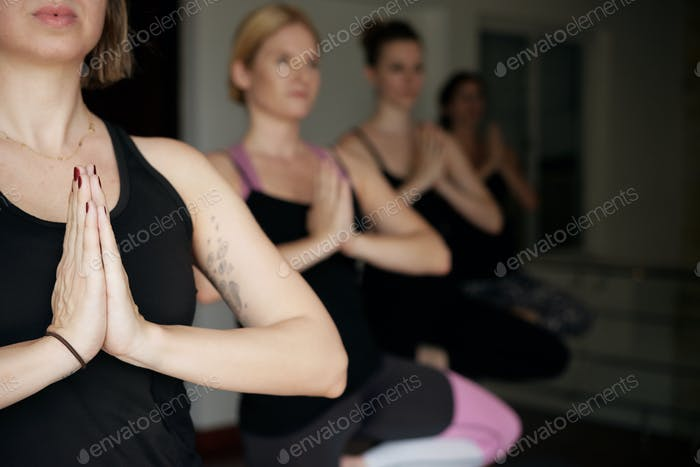 Meditating Young Women