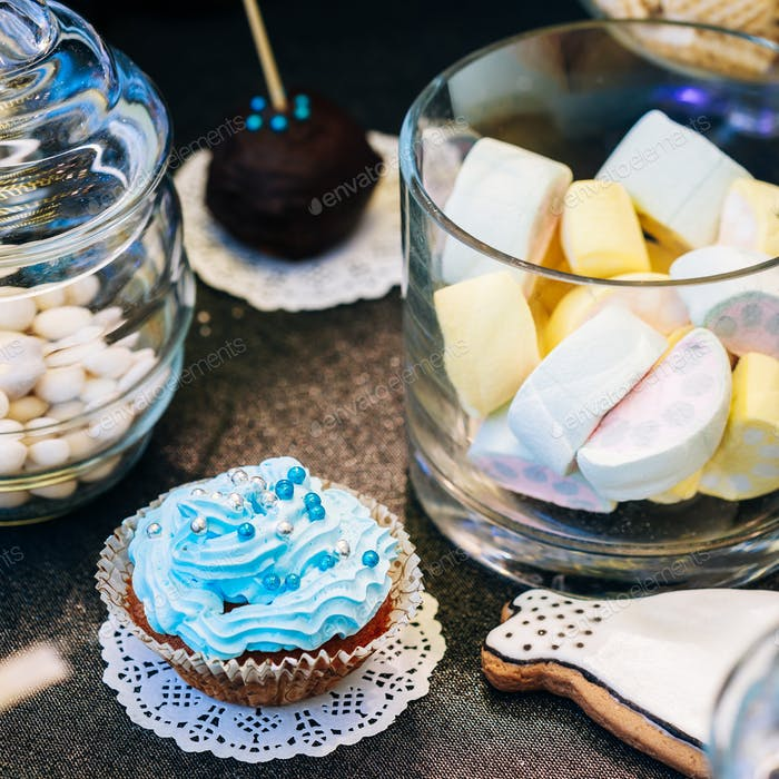 Dessert Sweet cupcakes  and marshmallow in Candy Bar On Table. D