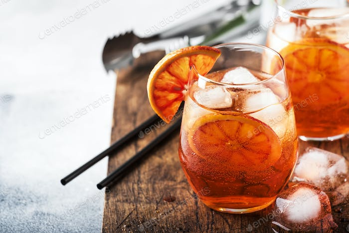 Aperol spritz cocktail in glass with sparkling wine