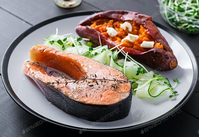 Healthy food: baked salmon and sweet potato and vegetables. Diet menu.