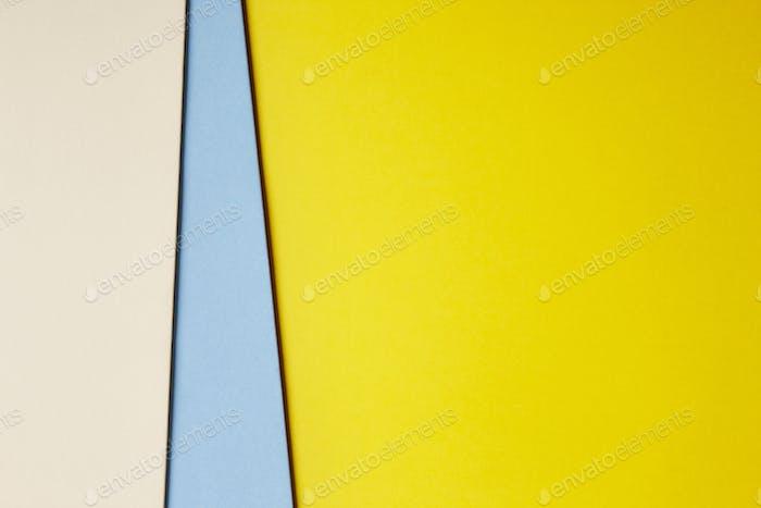 Farbige Pappe Hintergrund in beige blau gelb Ton. Kopierraum. Horizontal